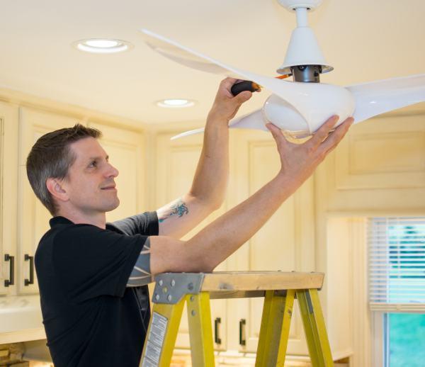 Miller & Miller Electrician installing ceiling fan